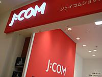 J_com